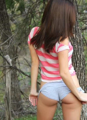 Horny girl Hunter Leigh enjoys baring her perfect tits and ass in the woods