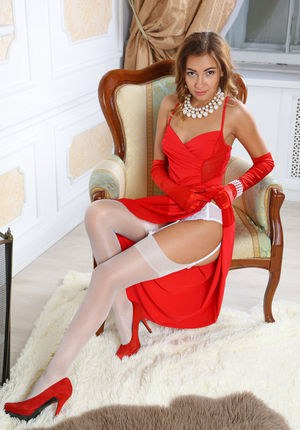 Beautiful elegant Jodie drops red gown to spread legs for shaved pussy closeup