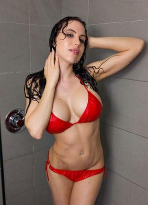 Amateur model Katie Banks peels off her red bikini underneath showers stream