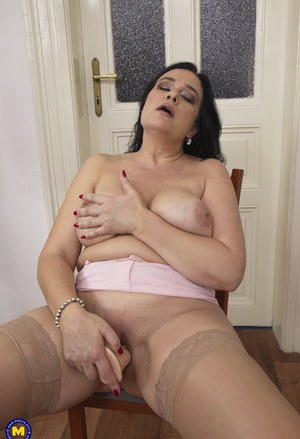 Chunky housewife strips down to tan stockings before masturbating