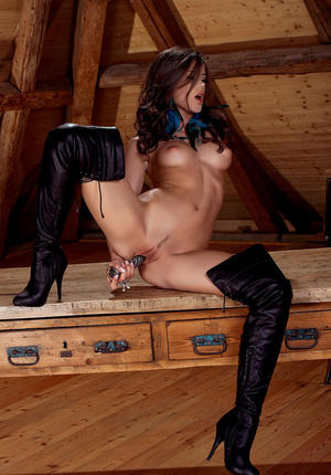 Glamour model Caprice masturbates with sex toy wearing stripper boots