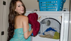 Cute chick Talia Shepard does laundry in spandex shorts while baring hooters