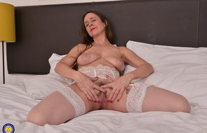 Mature older slut with saggy boobs practically begs for cock with legs spread