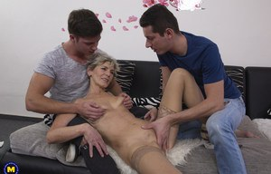 Sexy mature enjoys getting her small tits covered in young cum in MMF 3some