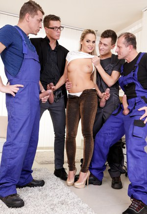 Blonde female Bara Brass rounds up a group of guys for a gangbang and a DP too