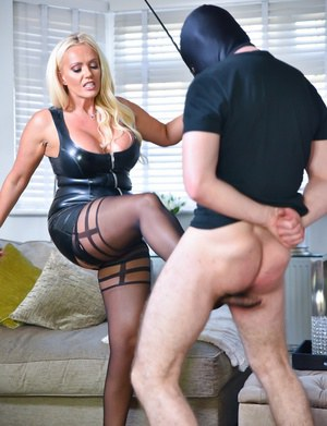 Dominant MILF in latex Lucy Zara tortures her male slave