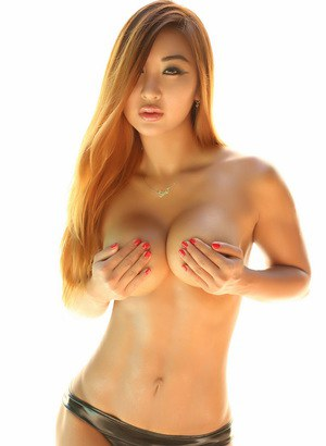 Hot redhead Darling Darla places hands over her tits after removing bikini top