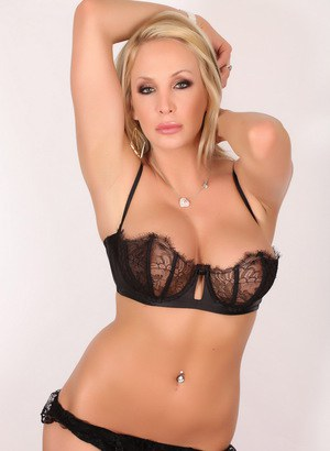 Busty blonde Alluring Vixen Eden shows off her huge boobs and tight body in skimpy black lace lingerie
