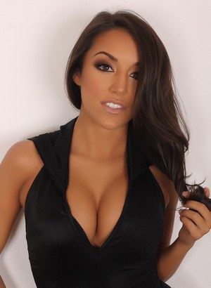 Stunning brunette Kasey posing in a black bodysuit to flaunt her big cleavage