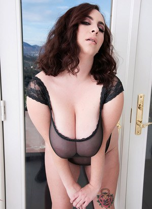 Plump brunette model Milly Marks releases her knockers from see thru onesie