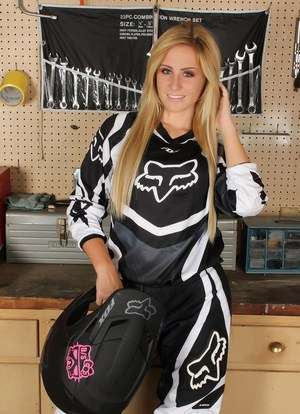 Amateur race driver Ashley Vallone strips her gear to tease in the garage