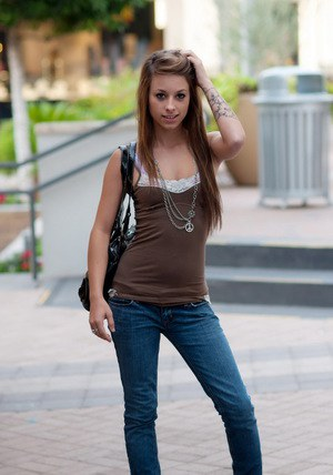 Naughty solo girl Riley Jensen flashes her tiny titties in public