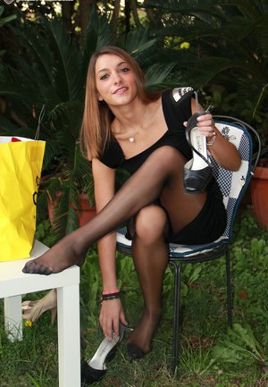 The garden party heats up when a sexy brunette bares her sexy pantyhose feet