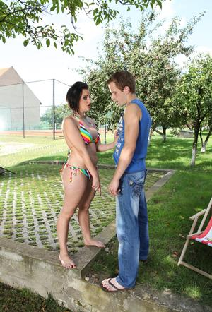 Horny big titted brunette gets naked in the yard for hot facesitting session