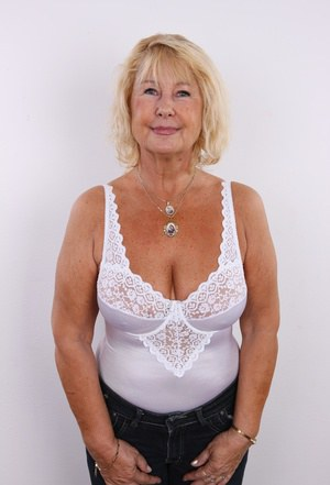 Old granny Regina strips for her first porno audition showing her saggy boobs