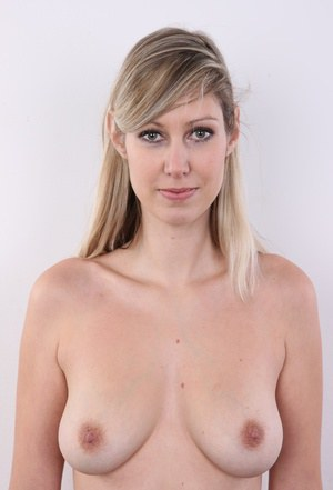 20 plus girl uncovers natural tits as she takes off her clothes