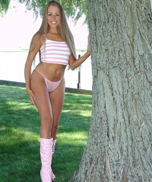 Amateur chick Lori Anderson strips to go-go dancer boots under a big tree