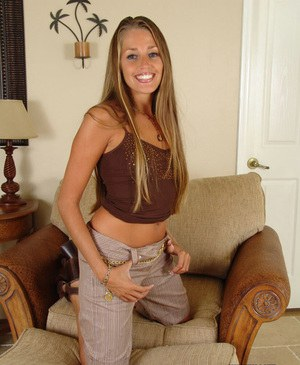 Leggy MILF Lori Anderson slips off long shorts before exposing tiny titties