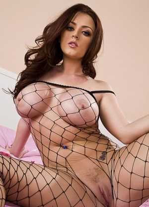 Curvy Sophie Dee poses in a see through net top and cute panties