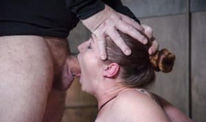 Fat female Bella Rossi gets mouth fucked while being restrained in dungeon