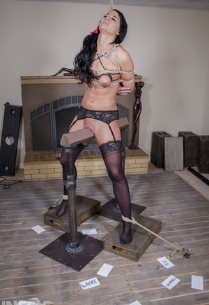 Brunette female London River is reduced to tears during a bondage session