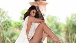 Tattooed Euro female Mica Martinez lets her see thru clothing fall by wayside