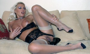 A peeping tom business man is spanked by Leggy Lana's high heel shoe, after she caught him watching her wanking