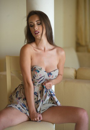 Solo girl Lauren Louise flashes her tits and ass in a summer dress