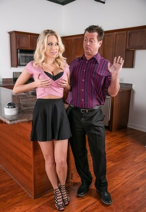 Big titted blonde in a black skirt gets banged on kitchen counter top