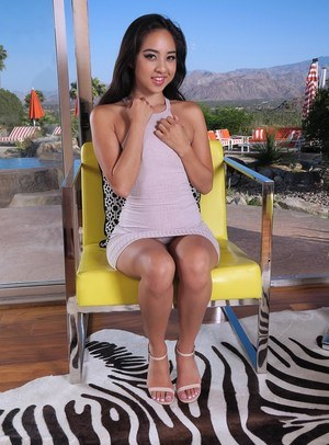 Hot Asian Mila Jade drops her panties on a deck chair for a pussy insertion