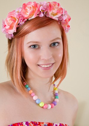 Natural redhead uncovers her perky teen boobs as she strips nake