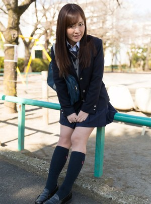 Japanese schoolgirl pulls down her cotton underwear during upskirt action