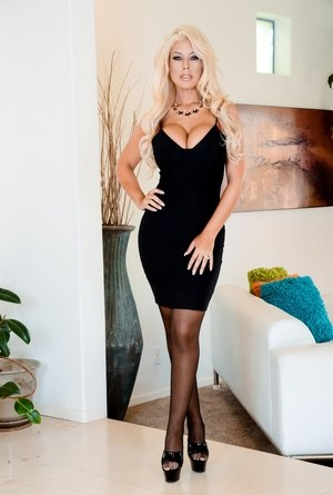 Blonde bombshell Bridgette B takes off her tight black dress to pose in nylons