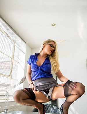 Hot blonde secretary Mikaela Witt in glasses & stockings topless on her desk