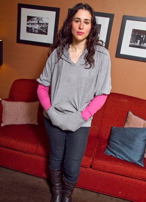 Hot amateur Marianna in tight jeans peeling off her sweater to bare big boobs
