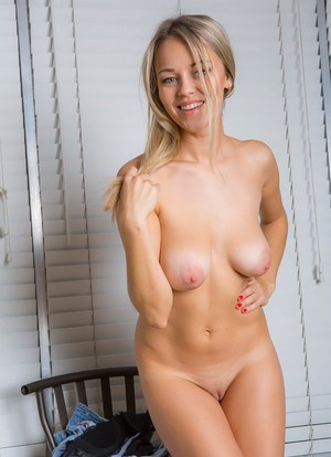 Slutty young blonde chick undressing to show off her saggy small tits