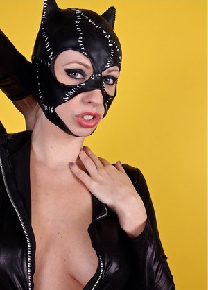 Naughty cat woman Lynn Pops pops her sexy tits out of provocative latex outfit