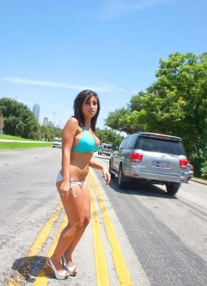 Brunette amateur Shami Halil models a bikini in the middle of a busy road