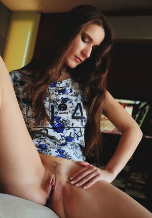 Slender brunette Elina shed shorts to spread ass and give pussy closeup