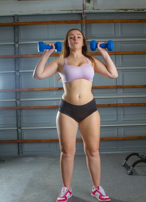 Sports girl Tiffany gets naked to exercise her pudgy body nude in the gym