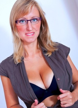 Ugly glasses clad Nikol removes her clothing to bare her nice breasts