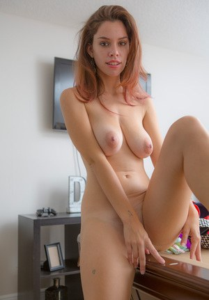 Slender hot redhead trying on her sexy underwear and showing her saggy tits
