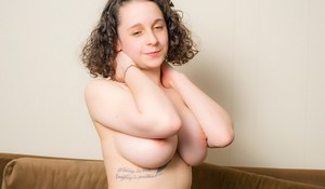 Young solo girl with fair skin unleashes her huge natural tits