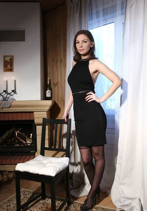Russian glamour model Galina A takes off her black dress while posing