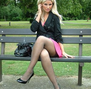 Clothed blonde in pink skirt showcases her nylon clad legs in new high heels