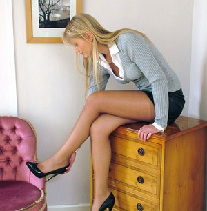Horny blonde in short skit wants to show off her long legs and gorgeous feet