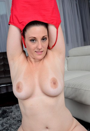 Flexible MILF Melanie Hicks displays firm big tits and stretches pussy lips