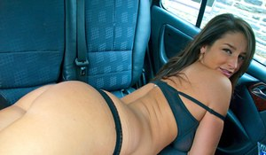 Amateur beauty Christine disrobes in the back seat of her car to show tits