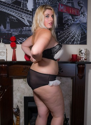 Blonde BBW removes her black dress and pretties to model in the nude