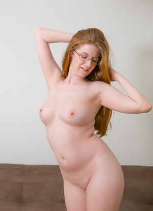 Natural redhead Andriel peels off her yoga pants to show her naked ass